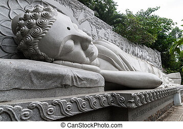 Sleeping Buddha - The marble statue of sleeping Buddha in...