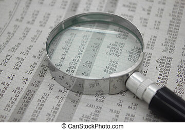 Stock price detail financial newspaper with magnifier. -...