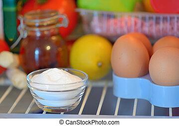 sodium bicarbonate inside of fridge, closeup