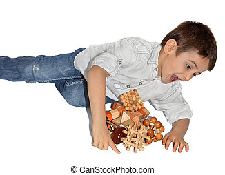 Wooden Brain Teaser - Joyful boy with many wooden logic toys