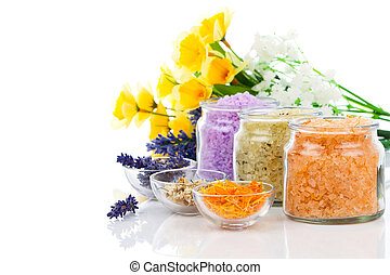 various kinds of bath salt with flowers, isolated on white...