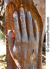 hand carved tree trunk. symbol photo