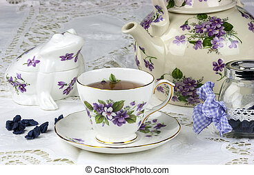 English afternoon tea with sweet and candied violets