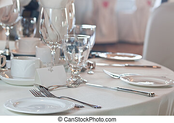 Closeup of wedding placesetting with blank placecard -...