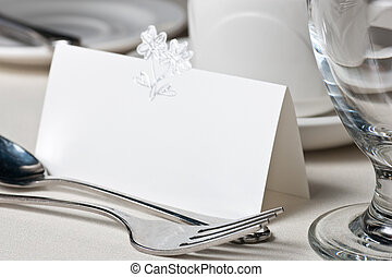 Closuep of blank placecard on wedding table - A closeup of a...