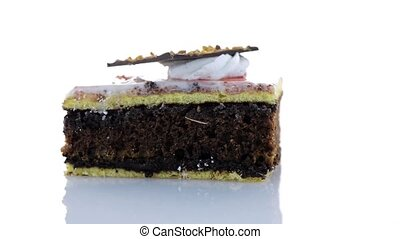 Piece of chocolate cake on white background