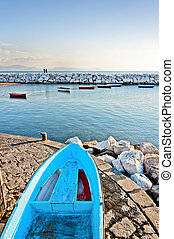 Mediterranean sea and boat in Naples bay - view of Naples...