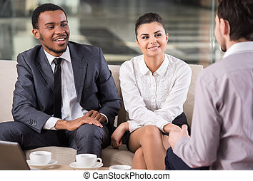 Business people - Group of smiling business partners are...