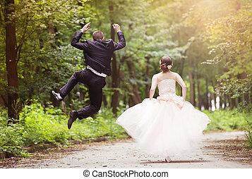 Running wedding couple - Wedding couple - bride and groom -...