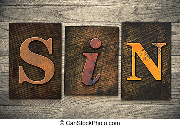Sin Concept Wooden Letterpress Type - The word SIN written...