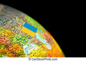 Map with Flag Ukraine. Globe detail with Selective Focus on...