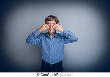 teenager boy Caucasian appearance eyes closed hands cross...