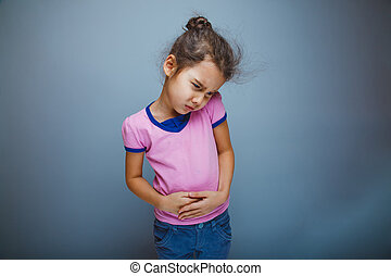 Teen girl child abdominal pain on gray background - Teen...