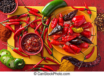 Hot Peppers - A group of bright colorful hot peppers on a...