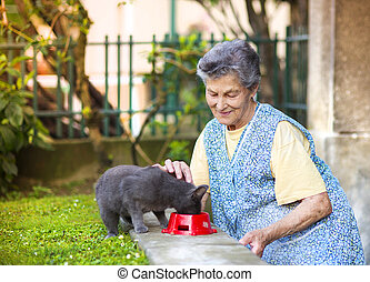 Senior woman with her cat