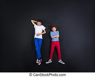 Boy and girl having fun together. - Playful young siblings...