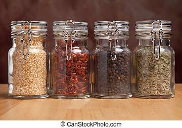 Bottles of Various Spices - Glass Bottles of Various Cooking...