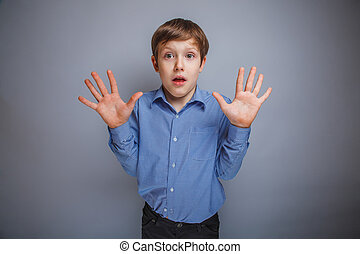 boy raised his hands, palms outward - boy raised his hands,...
