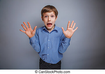 boy showing his hands gasped emotions - boy showing his...