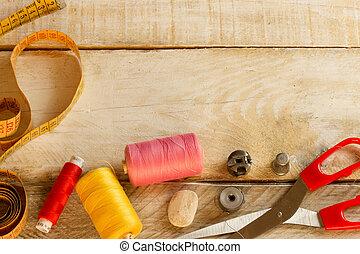 sewing items on a wooden table