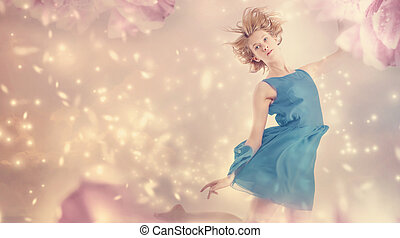Beautiful woman in a pink peony flower fantasy