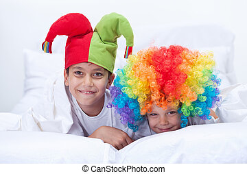Happy kids with clown hat and hair