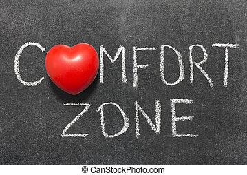 comfort zone phrase handwritten on blackboard with heart...