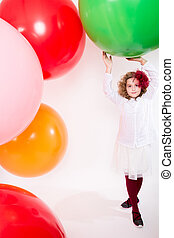 Teen girl in a hat and white dress on a background of big...