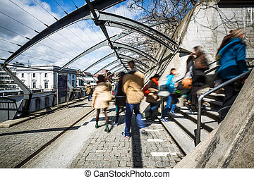 People in a city in motion