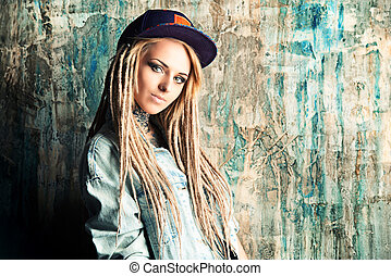teenager - Modern teenage girl with blonde dreadlocks. Jeans...