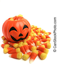 Pumpkin And Candy Corn - A plastic pumpkin filled with candy...