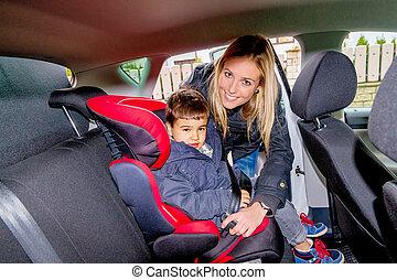 boy in a child seat - boy in a car seat, symbol of...