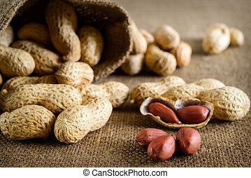 Peeled peanut on well peanuts in background