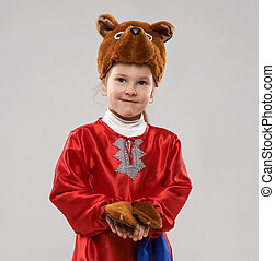 red-haired girl in a suit of the Slavic bear