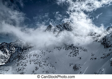 Morskie oko - Panoramic view of clouds passing over snowy...