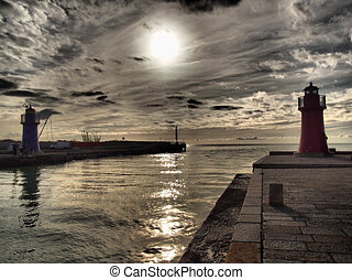 Port entrance at sunset with dramatic clouds; Castiglione...