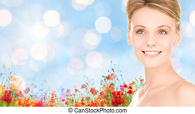 close up of smiling woman over natural background - people,...