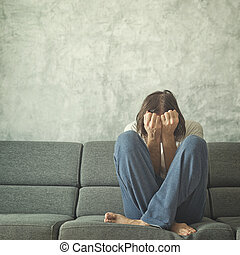 Deppresive Man - Depressed and sad man on the couch in the...
