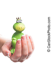 pince charming - a green frog sitting of sound in the hand...