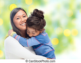 happy mother and daughter hugging - people, happiness, love,...