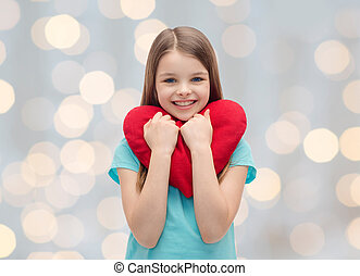 smiling little girl with red heart - love, charity,...
