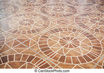 ceramic tile with geometrical drawing on floor