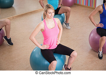 Fitness group training on fitball