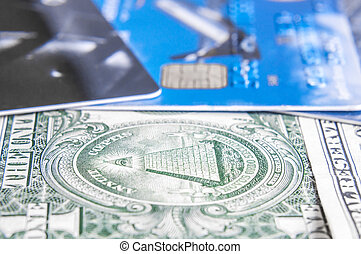 Close-up dollar note on credit card with shallow depth of field