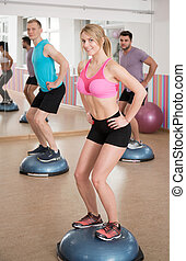 Balance training on the bosu - Fit people during balance...