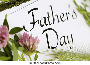 Fathers Day calligraphy type with grain and clover.