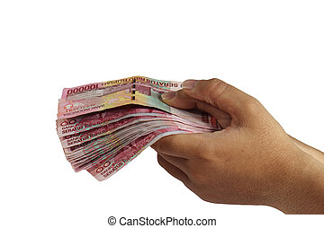 Holding 100000 Rupiah - Image of hand holding 100000 Rupiah...