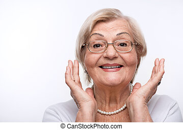 Elderly lady is happy - Happy lady. Beautiful senior woman...
