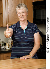 Elderly woman giving thumbs up