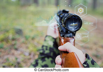 close up of soldier or sniper with gun in forest - hunting,...